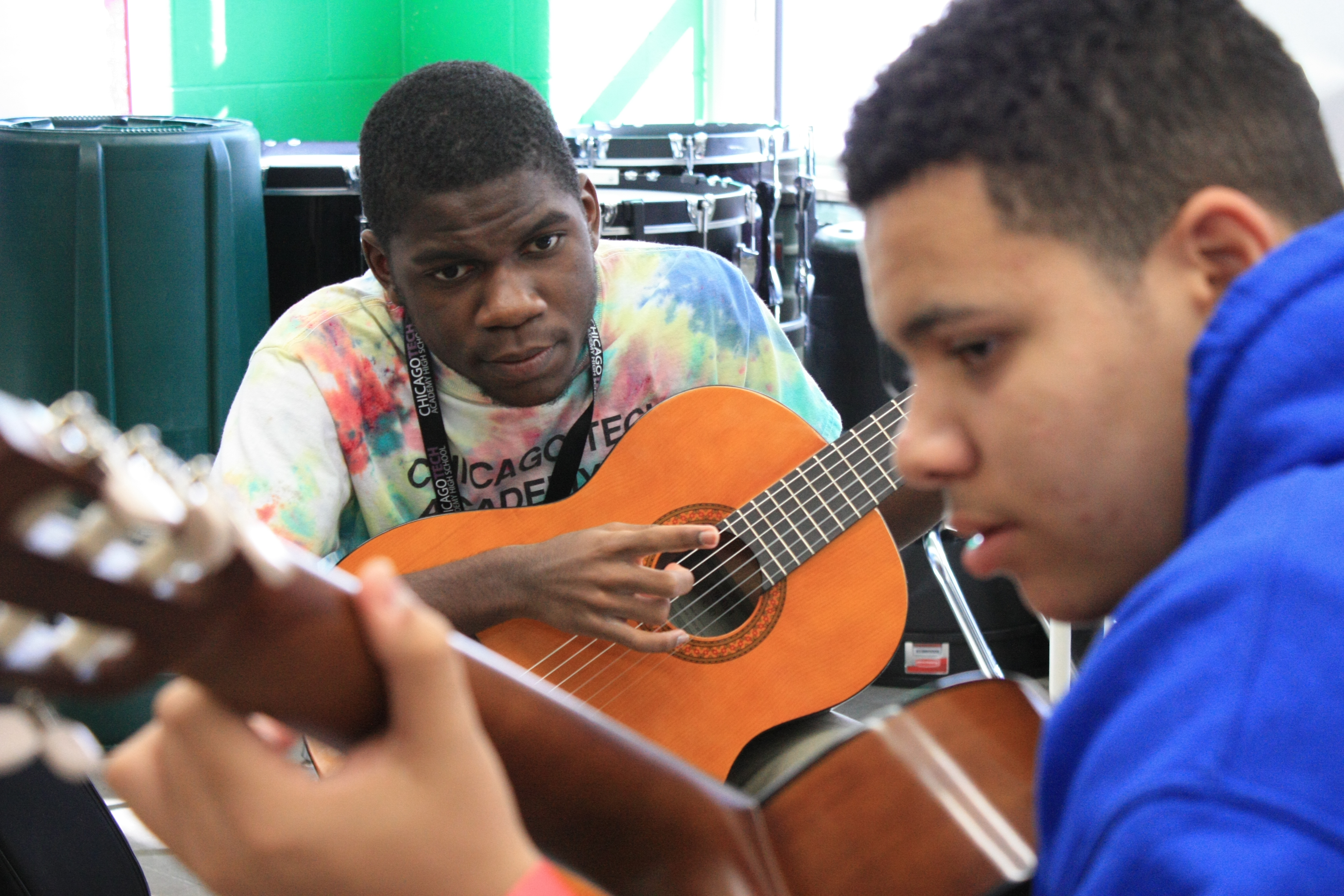 Lead Guitar high school students focus intently on playing a duo