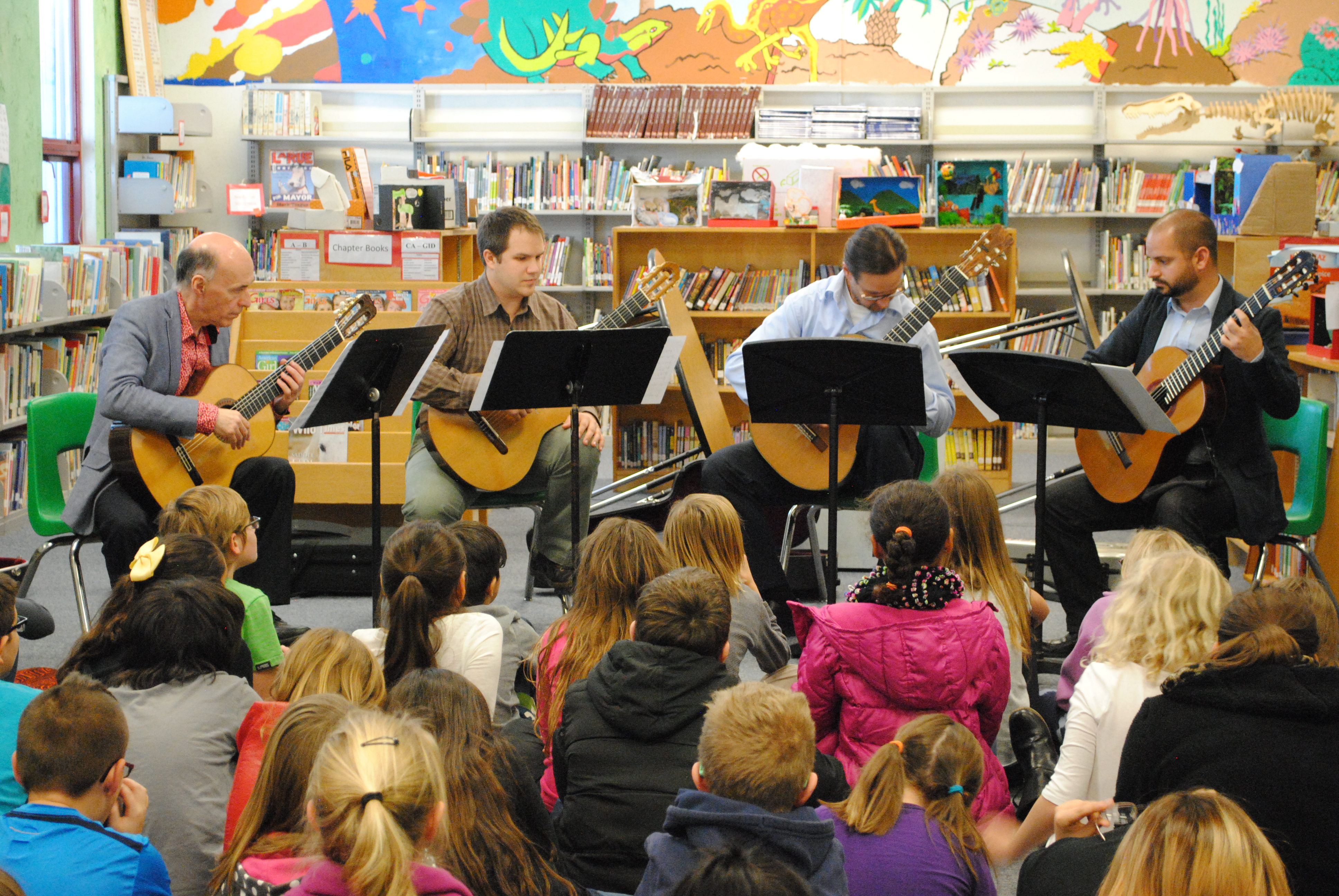 Lead Guitar guest artists perform for an elementary school